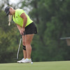 Norman North's Kaitlin Milligan putts her ball during the regional golf tournament, Tuesday, April 26, 2016, at Early Golf Course. (Kyle Phillips / The Transcript)