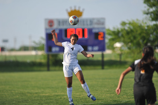 CCS's Mable Mayes heads the ball during the Royals' game against Madill Monday, April 26, 2016. (Kyle Phillips / The Transcript)