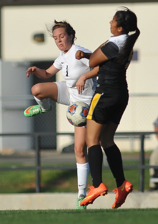 CCS's Carlee Apel kicks the ball during the Royals' game against Madill Monday, April 26, 2016. (Kyle Phillips / The Transcript)