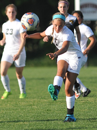 CCS's Laura Benrens kicks the ball during the Royals' game against Madill Monday, April 26, 2016. (Kyle Phillips / The Transcript)