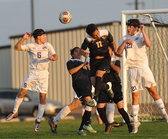 CCS's Michael Anderson (5) tries to head the ball during the Royals' game against Madill Monday, April 26, 2016. (Kyle Phillips / The Transcript)
