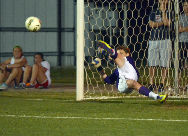 Norman North goalie Jackson Biles pushes away a ball stopping Norman high from scoring on a penalty kick Friday night during the Clash soccer match at Norman North.  The Timberwolves won the game 2-1.<br /> Kyle Phillips/The Transcript