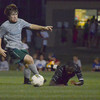 Norman North's Ashton Bray picks up the ball after Norman High's Charles Makinda (10) gets tripped up Friday night during the Clash soccer match at Norman North.  The Timberwolves won the game 2-1.<br /> Kyle Phillips/The Transcript
