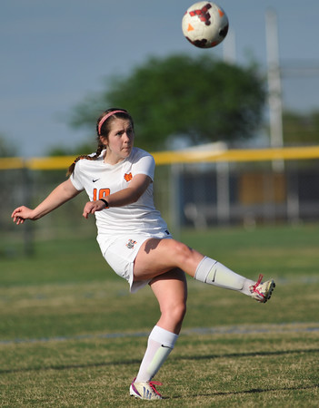 Norman High's Lexi Fowler kicks  the ball during the Tigers' game against Edmond Memorial Monday, April 26, 2016. (Kyle Phillips / The Transcript)