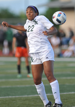 Norman North's Yazmeen Ryan tries to head the ball during the Timberwolves' game against Putnam City Tuesday, April 19, 2016. (Kyle Phillips / The Transcript)