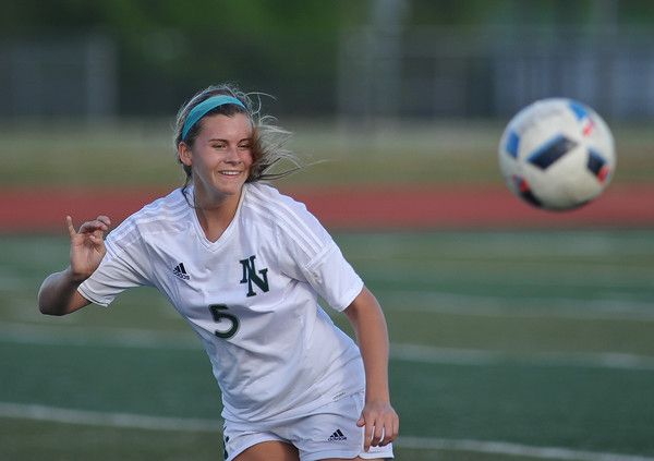 Norman North's Camille Greer watches the ball during the Timberwolves' game against Putnam City Tuesday, April 19, 2016. (Kyle Phillips / The Transcript)