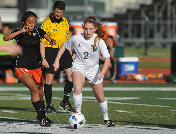 Norman North's Tori Wilpitz controls the ball during the Timberwolves' game against Putnam City Tuesday, April 19, 2016. (Kyle Phillips / The Transcript)