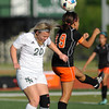 Norman North's Mary Davis heads the ball during the Timberwolves' game against Putnam City Tuesday, April 19, 2016. (Kyle Phillips / The Transcript)