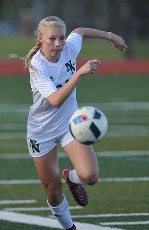 Norman North's Ella McCarty runs toward the ball during the Timberwolves' game against Putnam City Tuesday, April 19, 2016. (Kyle Phillips / The Transcript)