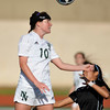 Norman North's Alex Wynn heads the ball during the Timberwolves' game against Putnam City Tuesday, April 19, 2016. (Kyle Phillips / The Transcript)
