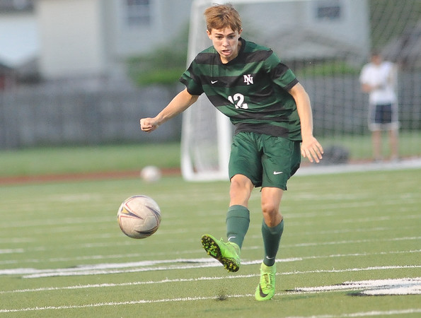 Norman North's David Menzie kicks the ball during the Timberwolves' game against Southmoore Monday, April 25, 2016. (Kyle Phillips / The Transcript)