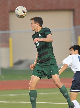 Norman North's Goash Williams  head the ball during the Timberwolves' game against Southmoore Monday, April 25, 2016. (Kyle Phillips / The Transcript)