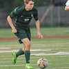 Norman North's David Menzie controls the ball during the Timberwolves' game against Southmoore Monday, April 25, 2016. (Kyle Phillips / The Transcript)