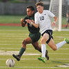 Norman North's Landen McClellan goes after the ball during the Timberwolves' game against Southmoore Monday, April 25, 2016. (Kyle Phillips / The Transcript)