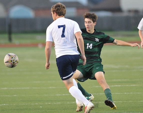 Norman North's Blake Barnard goes after the ball during the Timberwolves' game against Southmoore Monday, April 25, 2016. (Kyle Phillips / The Transcript)