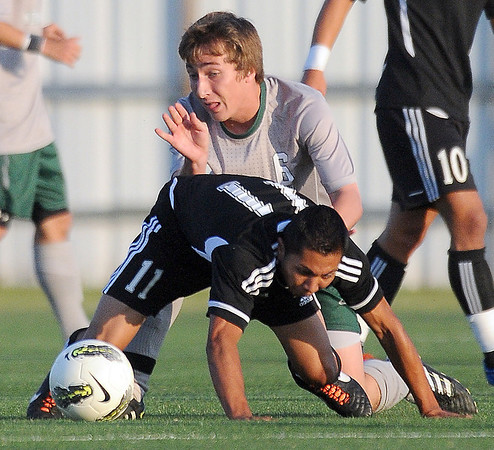 Norman North midfielder Michael Henke (6) and Chris Perez (11) acemble for the ball Tuesday, May 8, 2012, during a Class 6A boys soccer semifinal game. Photo by Jerry Laizure