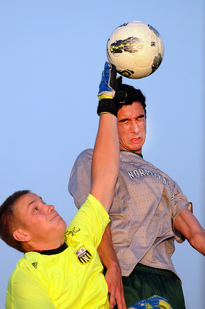 Broken Arrow goalkeeper John Morris blocks a Norman North shot while Norman North's Mauro Chichero tries to head the ball Tuesday, May 8, 2012, in a Class 6A semifinal game in Norman. Photo by Jerry Laizure