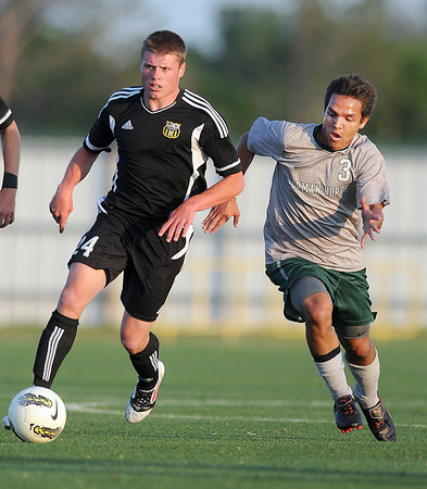 Broken Arrow's Tyler Hill (24)  advances the ball while Norman North's Brandon Little Axe pursues him  Tuesday, May 8, 2012, during a Class 6A boys soccer semifinal game. Photo by Jerry Laizure