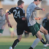 Norman North's Mauro Chichero (14) and Broken Arrow's Tyler Hill (24) battle for the ball Tuesday, May 8, 2012, during a Class 6A boys soccer semifinal game. Photo by Jerry Laizure