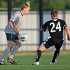 Norman North midfielder Jonanthan Newton (20) controls the ball in front of Broken Arrow's Tyler Hill (24) Tuesday, May 8, 2012, during a Class 6A boys soccer semifinal game. Photo by Jerry Laizure