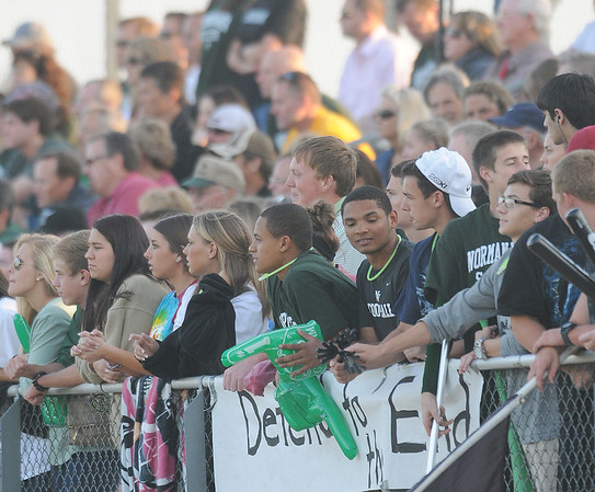 Norman North fans cheer Tuesday, May 8, 2012, during a Class 6A boys soccer semifinal game against Broken Arrow. Photo by Jerry Laizure