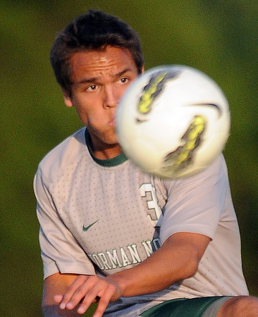 Norman North's Brandon Little Axe centers the ball Tuesday, May 8, 2012, during a Class 6A boys soccer semifinal game against Broken Arrow. Photo by Jerry Laizure