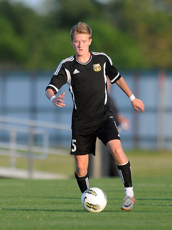 Broken Arrow's Brandon Hatfield advances the ball Tuesday, May 8, 2012, during a Class 6A boys soccer semifinal game. Photo by Jerry Laizure
