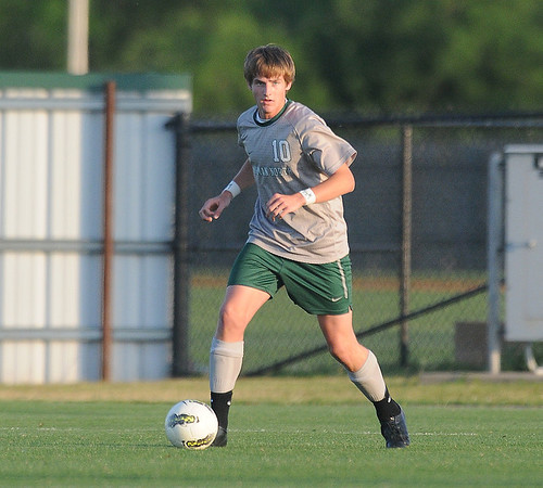 Norman North's Curtis McRae advances the vall Tuesday, May 8, 2012, during a Class 6A boys soccer semifinal game. Photo by Jerry Laizure