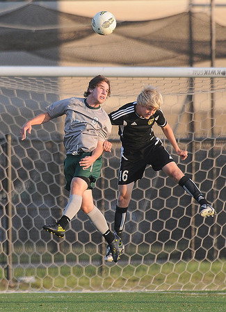 Norman North defender Ashton Bray (3) protects the goal as Broken Arrow forward Landen Merrill (16) tries to score Tuesday, May 8, 2012, during a Class 6A boys soccer semifinal game. Photo by Jerry Laizure