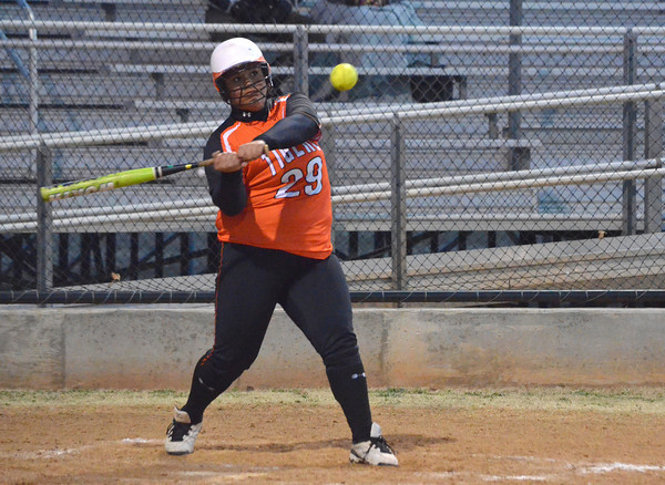 Norman High's Kiyanna Hibbert makes contact with the ball during her Tuesday during the Clash softball game.<br /> Kyle Phillips/The Transcript