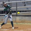 Norman North's Raysha Carter makes contact with the ball Tuesday during the Clash softball game.<br /> Kyle Phillips/The Transcript