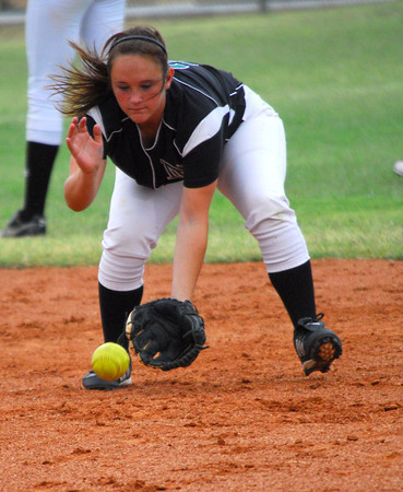 Norman North's K. Ruth picks up a ground ball Tuesday evening during the Clash softball game at Norman North,<br /> Kyle Phillips/The Transcript