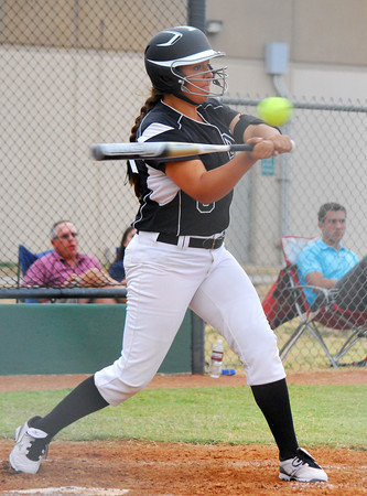 Norman North's M. Wardlow makes contact with the ball Tuesday evening during the Clash softball game at Norman North.<br /> Kyle Phillips/The Transcript