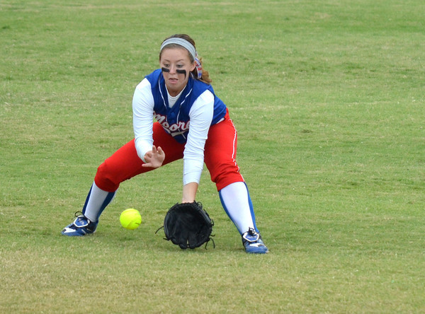 Moore High School's (3) picks up a ground ball during the Lions' game against Broken Arrow Friday at the ASA Hall of Fame Stadium.<br /> Kyle Phillips/The Transcript