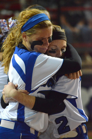 Moore High School's Qiana Harrison, left, and Caiti Hall (2) reacts after the Lions lose the 6A state fast pitch softball championship Monday at ASA Hall of Fame Stadium in Oklahoma City.  Edmond won the game 11-2.<br /> Kyle Phillips/The Transcript