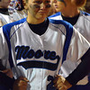 Moore High School's Jazmine White (21) reacts after the Lions lose the 6A state fast pitch softball championship to Edmond North Monday night at the ASA Hall of Fame Stadium in Oklahoma City.  Edmond wom the game 11-2.<br /> Kyle Phillips/The Transcript