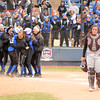 Sequoyah-Tahlequah catcher Rain Thompson (13) walks back to the dugout as Little Axe celebrates winning the 3A State Fastpitch Softball Championship game Saturday at the ASA Hall of Fame Stadium in Oklahoma City.<br /> Kyle Phillips/The Transcript