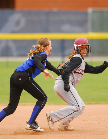 Little Axe's Aubree Branch (17) tags out Sequoyah-Tahlequah's Rhanda Walker (2)  during the 3A state fast pitch softball championship game Saturday at Hall of Fame Stadium in Oklahoma City.<br /> Kyle Phillips/The Transcript