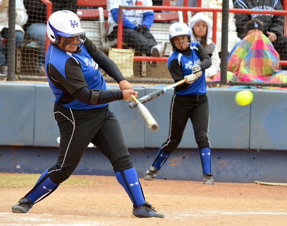 Little Axe's Andee Fraizer (1) makes contact with the ball during her turn at bat during the 3A state fast pitch softball championship game Saturday at Hall of Fame Stadium in Oklahoma City.<br /> Kyle Phillips/The Transcript