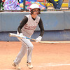 Sequoyah-Tahlequah's Kara Linch (4) runs toward first after bunting the ball during her turn at bat during the 3A state fast pitch softball championship game Saturday at Hall of Fame Stadium in Oklahoma City.<br /> Kyle Phillips/The Transcript