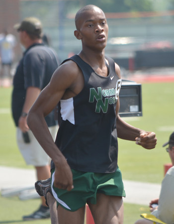 Norman North's Josh Beal competes in the boy's 800 meter run Saturday afternoon at the 2012 reginal track meet at Mustang High School.<br /> Kyle Phillips/The transcript