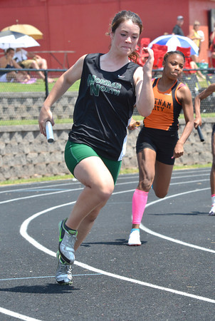 Norman North's Sarah Ex competes in the first leg of the 4x100 relay Saturday afternoon at the 2012 reginal track meet at Mustang High School.<br /> Kyle Phillips/The transcript