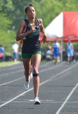Norman North's Haley Woodard crosses the finish line in the girl's 400m dash Saturday afternoon at the 2012 reginal track meet at Mustang High School.<br /> Kyle Phillips/The transcript