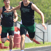Norman North's Corbin Cleveland lunges across the finish line in the boy's 400 meter dash Saturday afternoon at the 2012 reginal track meet at Mustang High School.<br /> Kyle Phillips/The transcript