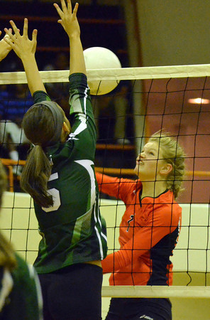 Norman North's Sarah Sheldon (5) blocks a shot by Norman High's Katie Willeford (3) Tuesday during the Clash volleyball game at Norman High.<br /> Kyle Phillips/The Transcript