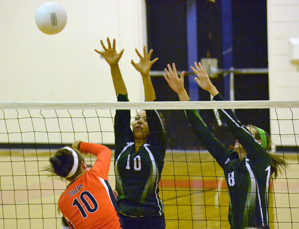 Norman North's McKayla Benner(10) and Madison Brammer (8) blocj a shot by Norman High's Lyndia Price (10) Tuesday during the Clash volleyball game at Norman High.<br /> Kyle Phillips/The Transcript
