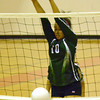 Norman North's McKayla Benner (10) taps the ball over the net Tuesday during the Clash volleyball game at Norman High School.<br /> Kyle Phillips/The Transcript