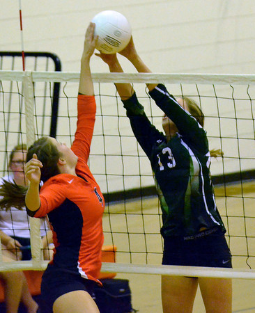 Norman High's Kyla Newell blocks a shot by Norman North's Haley Reed (13) Tuesday during the Clash volleyball game at Norman High School.<br /> Kyle Phillips/The Transcript