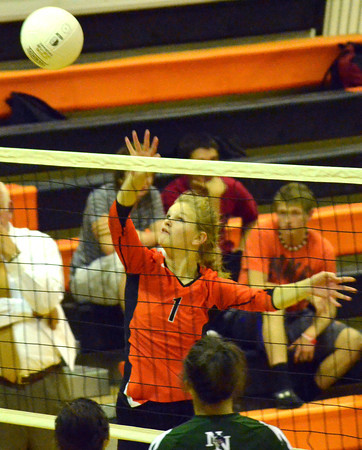 Norman High's Jeralyn Magne (1) hits the ball over the net Tuesday during the Clash volleyball game at Norman High School.<br /> Kyle Phillips/The Transcript