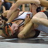 Norman High's Lucas Stanfield  tries to break free from a hold put on him by Norman North's Jack Thorton Thursday during the Clash wrestling match at Norman North.<br /> Kyle Phillips/The Transcript